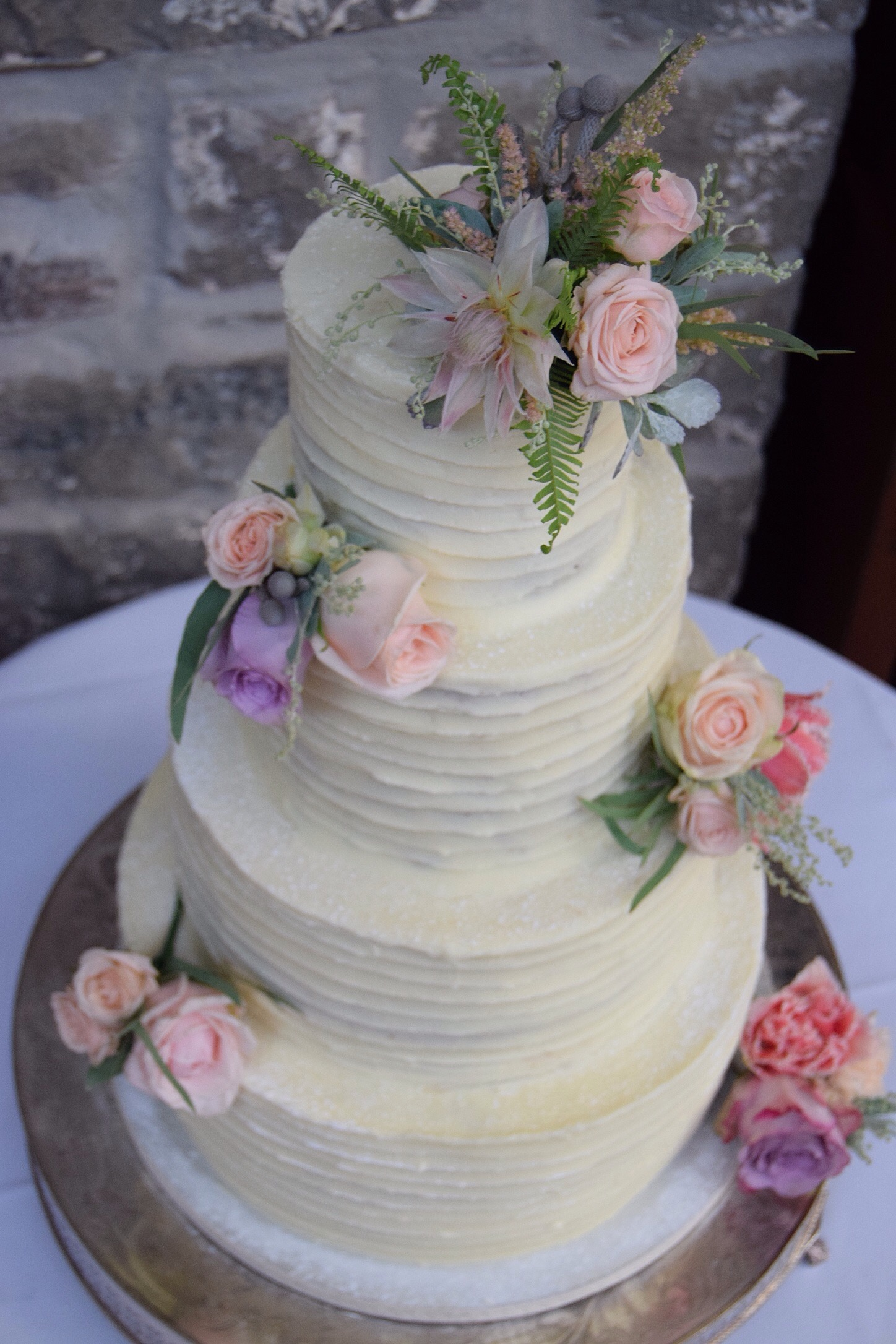 Buttercream 4 tier with fresh flowers