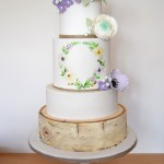 4 tier with birch effect bottom tier and hand painted floral design